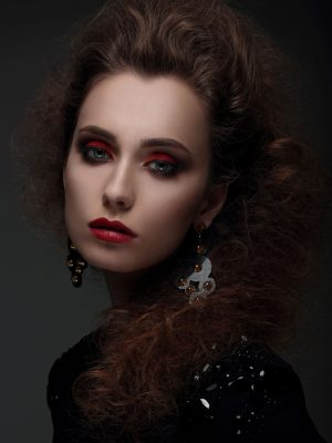 portrait-of-a-woman-with-high-hair-and-red-lips-P8JVKUW